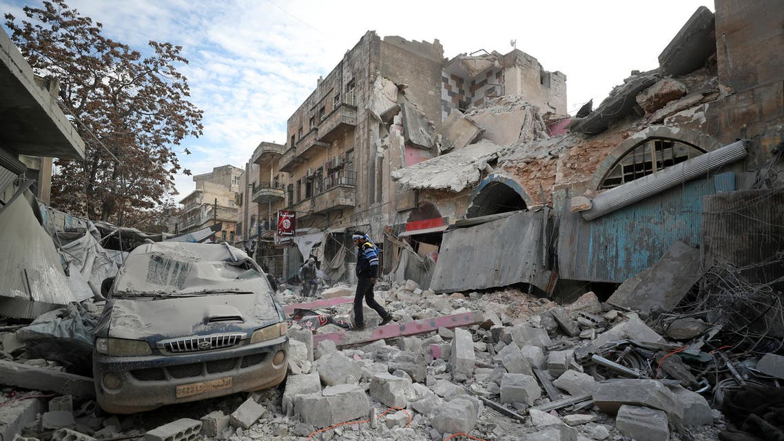 A Syrian walks on the rubble of a building following an air strike on Idlib on January 15, 2020. (AFP)