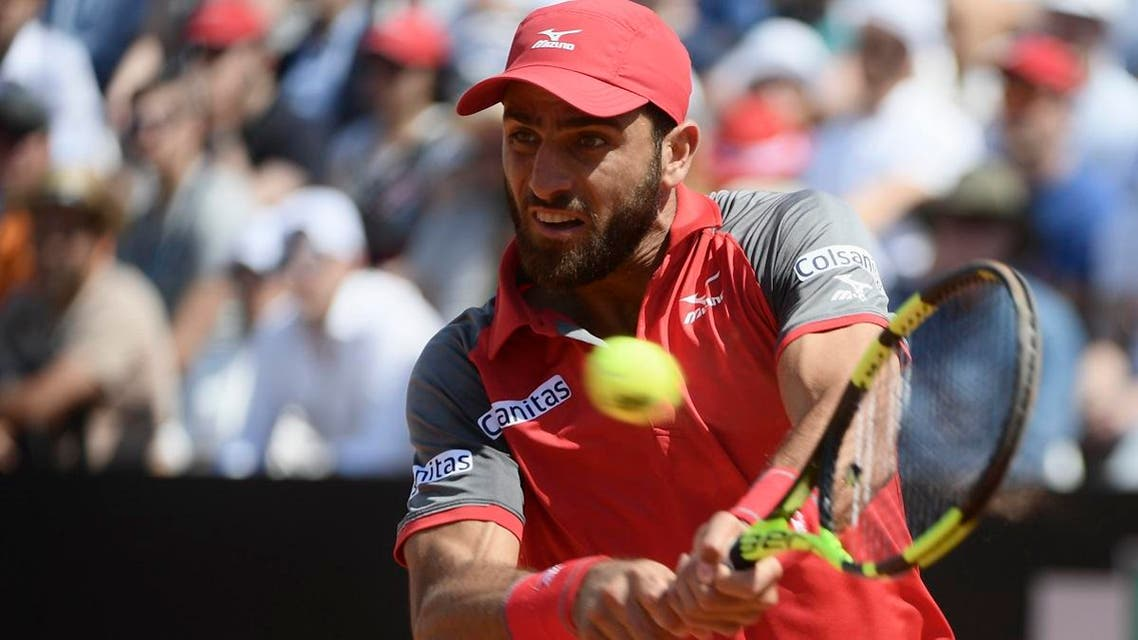 Colombia's Robert Farah Maksoud hits a return during pair final with teammate Colombia's Juan Sebastian Cabal against Joao Sousa and Pablo Carreno Busta at Rome's ATP Tennis Open tournament at the Foro Italico, on May 20, 2018 in Rome. (AFP)