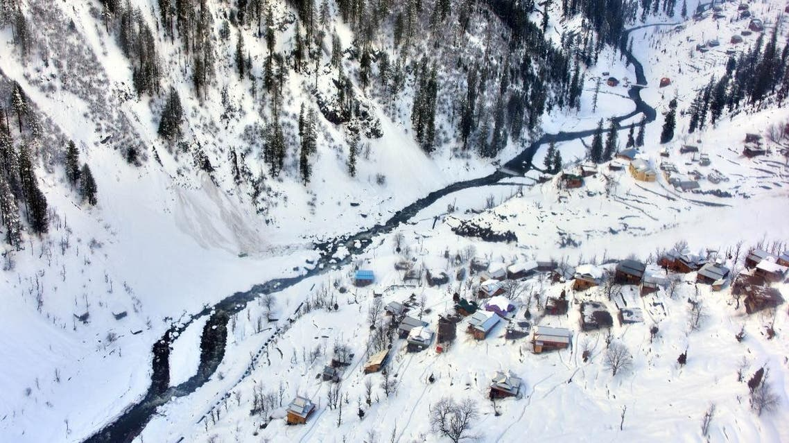 A general view of houses covered with heavily snow is pictured in Neelum Valley, in Pakistan-administered Kashmir on January 16, 2020. (AFP)