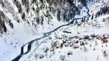 Rescuers hunt for survivors as Pakistan landslide death toll rises to 77