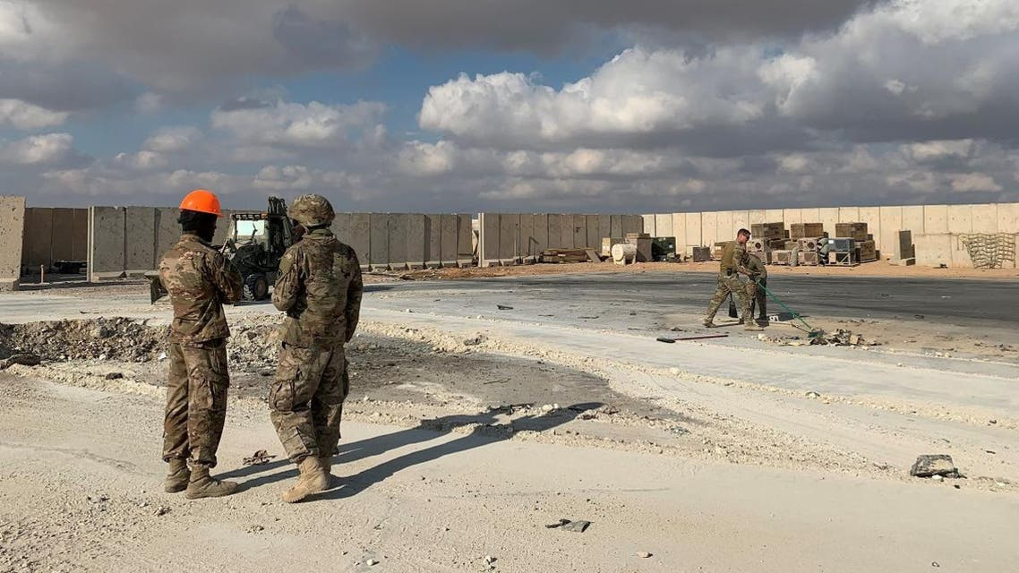 A picture taken on January 13, 2020 during a press tour organised by the US-led coalition fighting the remnants of the Islamic State group, shows US soldiers clearing rubble at Ain al-Asad military airbase in the western Iraqi province of Anbar. (AFP)