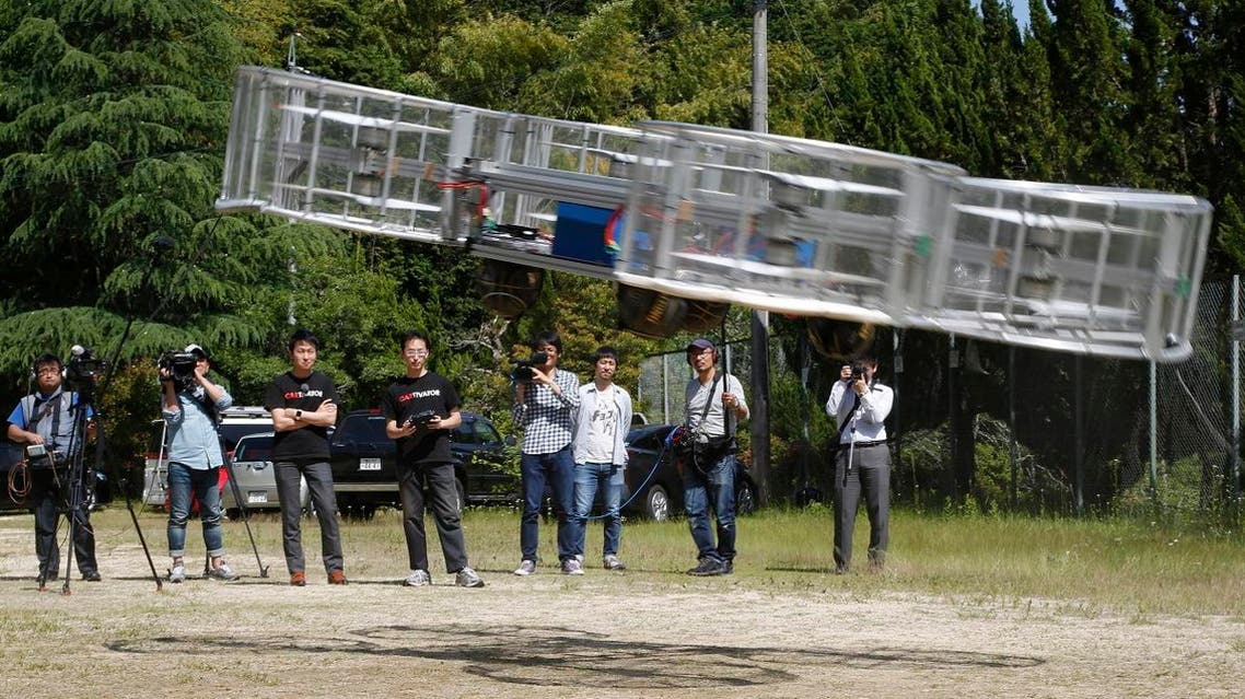 Project leader of Cartivator Tsubasa Nakamura watches the flight of the test model of the flying car on a former school ground in Toyota, central Japan, Saturday, June 3, 2017. (File photo: AP)