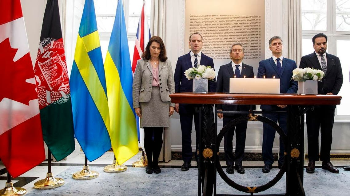 (L-R) Swedish Minister of Foreign Affairs Ann Linde, Ukrainian Minister of Foreign Affairs Vadym Prystaiko, Britain's Foreign Secretary and First Secretary of State Dominic Raab and Canadian Minister of Foreign Affairs Francois-Philippe Champagne share a minute's silence for the families of the victims of the Ukrainian plane shot down in Iran before a meeting of the International Coordination and Response Group, at the High Commission of Canada in London, on January 16, 2020. (AFP)