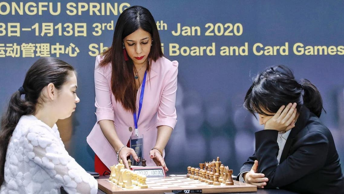 Shohreh Bayat (C), chief arbiter for the match between Aleksandra Goryachkina (front L) of Russia and Ju Wenjun (front R) of China, prepares for the match during the 2020 International Chess Federation (FIDE) Women's World Chess Championship in Shanghai on January 11, 2020. (AFP)