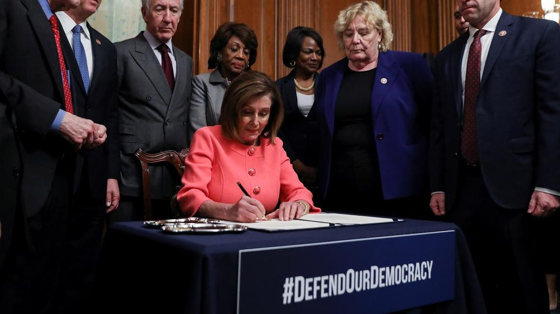 US House Speaker Pelosi holds engrossment ceremony to sign Trump impeachment articles at the US Capitol in Washington. (Reuters)