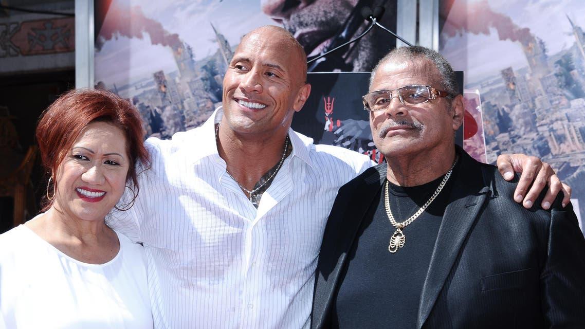 Dwayne Johnson with Parents Ata Johnson and Rocky Johnson. (AP)