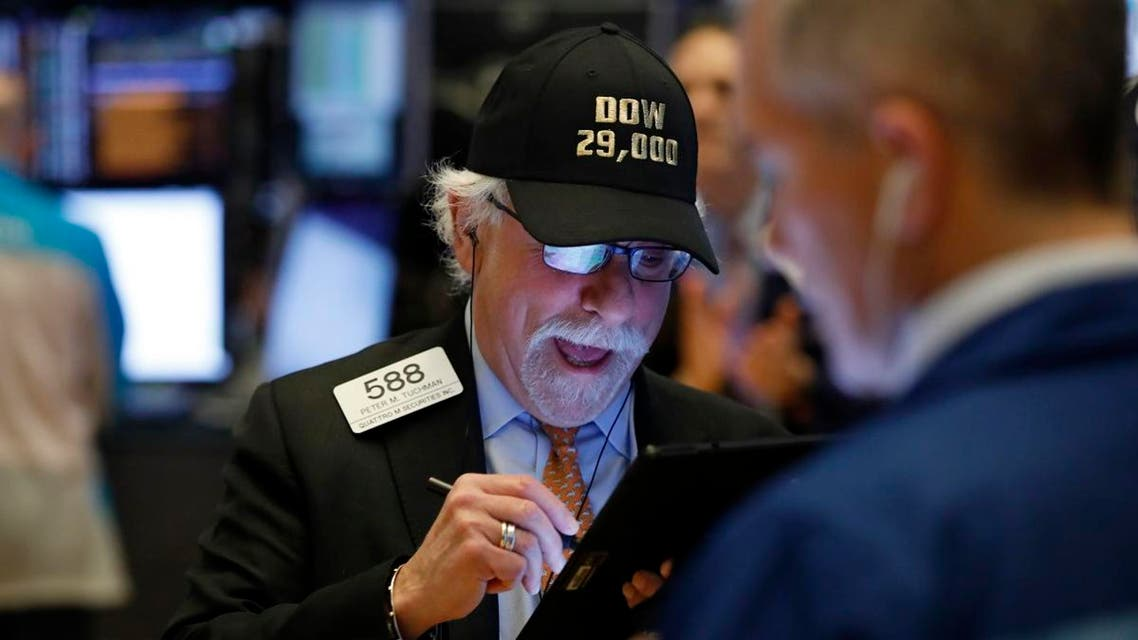 """Trader Peter Tuchman wears his """"Dow 29,000"""" hat as he works on the floor of the New York Stock Exchange, on January 15, 2020, as the Dow Jones industrial average closed above 29,000 for the first time. (AP)"""