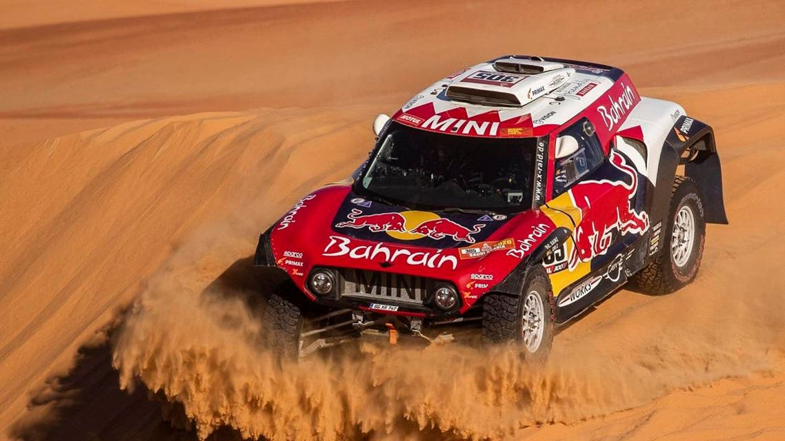 Driver Carlos Sainz, of Spain, and co-driver Lucas Cruz, of Spain, race their Mini during stage eleven of the Dakar Rally between Shubaytah and Haradth, Saudi Arabia, Thursday, Jan. 16, 2020. (AP)