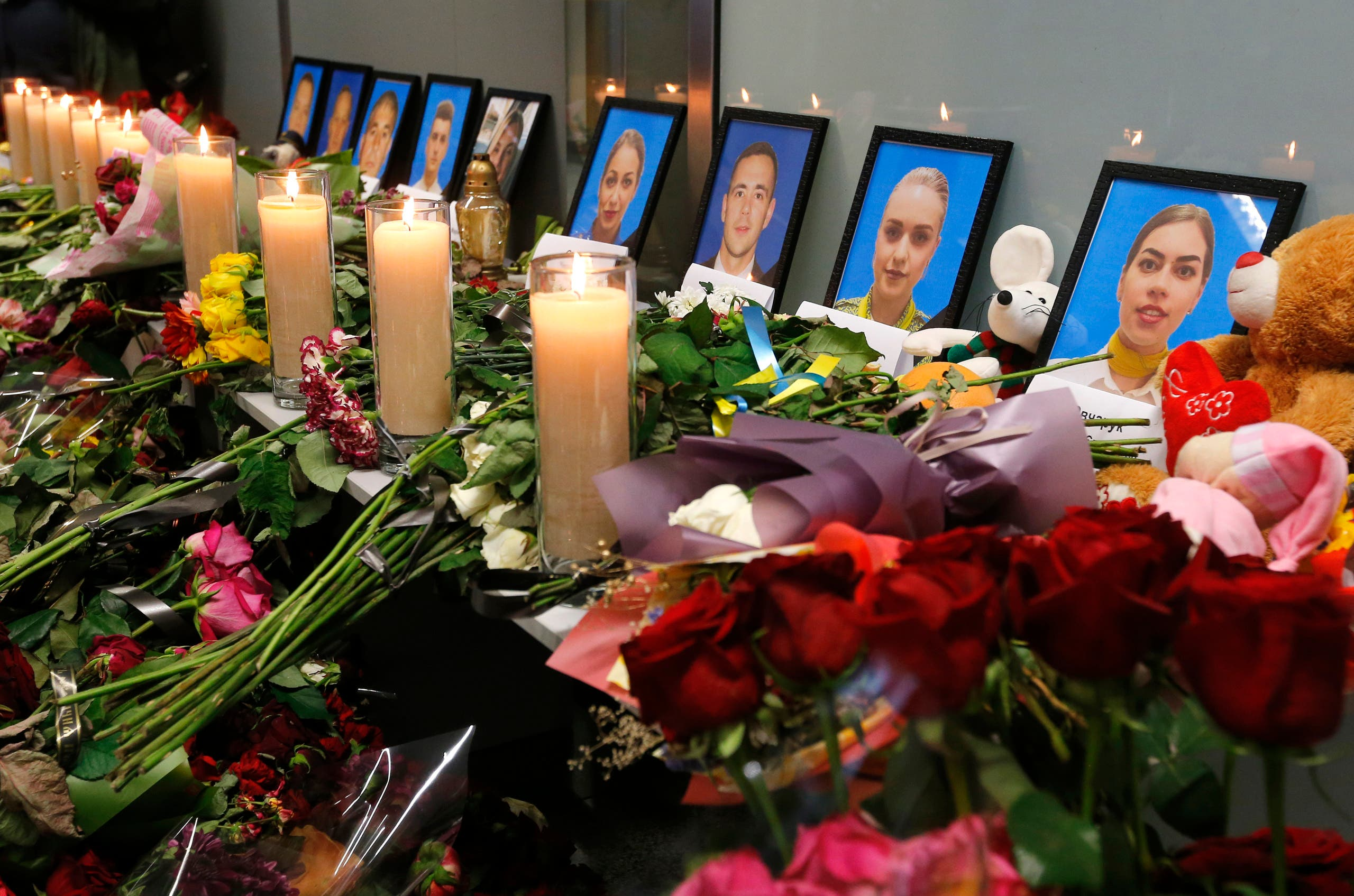 Download now     Flowers and candles are placed in front of portraits of the flight crew members of the Ukrainian 737-800 plane that crashed on the outskirts of Tehran, at a memorial inside Borispil international airport outside Kyiv, Ukraine, Saturday, Jan. 11, 2020. (AP)