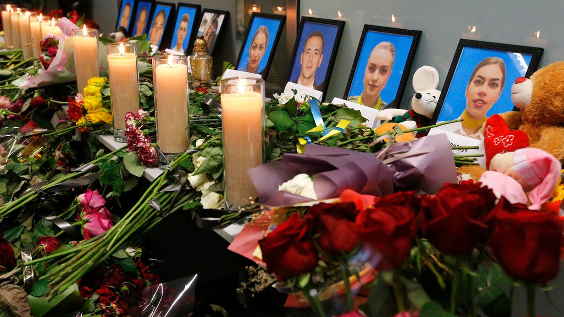 Download now     Flowers and candles are placed in front of portraits of the flight crew members of the Ukrainian 737-800 plane that crashed on the outskirts of Tehran, at a memorial inside Borispil international airport outside Kyiv, Ukraine, Saturday, Jan. 11, 2020. AP