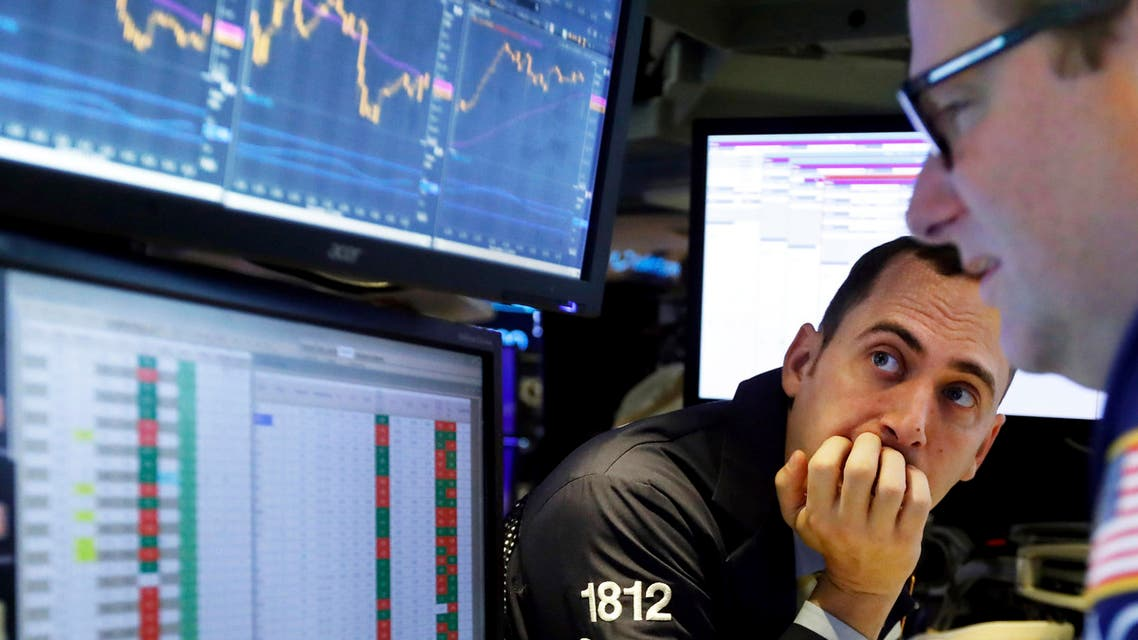 In this Nov. 14, 2019, file photo a pair of specialists work on the floor of the New York Stock Exchange. (AP)