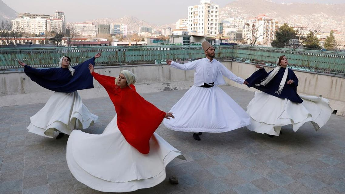 Fahima Mirzaie, 23, founder of a Sama Dance group dances with her teammates in Kabul, Afghanistan, on December 9, 2019. (Reuters)