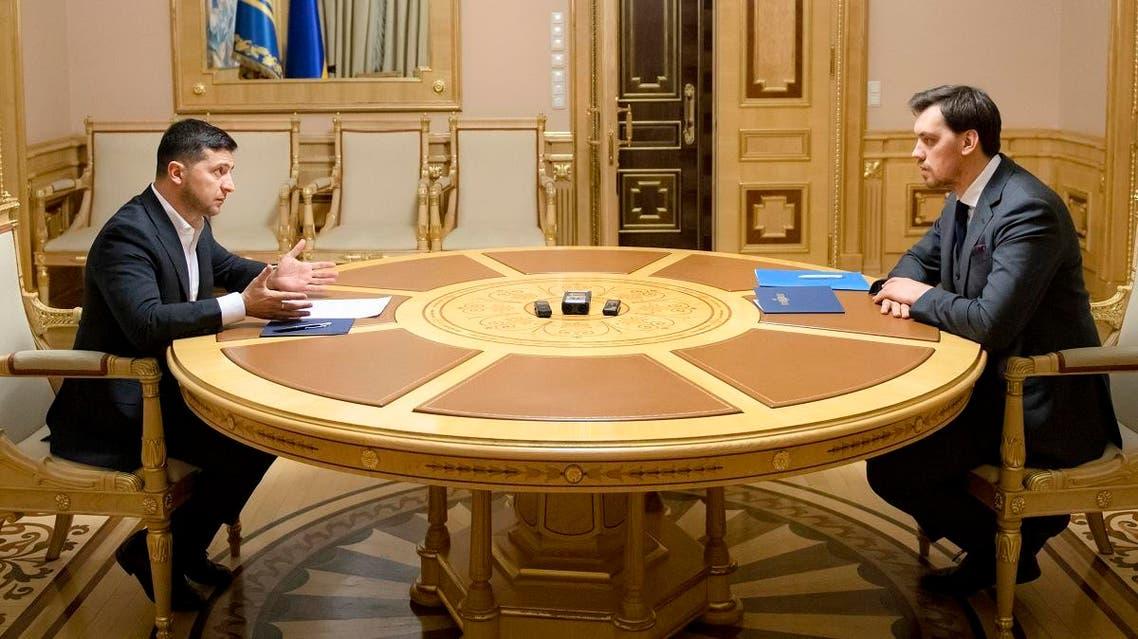 In this photo provided by the Ukrainian Presidential Press Office, Ukrainian President Volodymyr Zelenskiy, left, talks with Ukraine's Prime Minister Oleksiy Honcharuk in Kyiv, Ukraine, Friday, Jan.17, 2020. (AP)