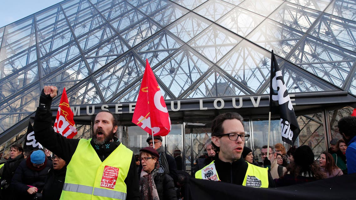 Striking employees demonstrate outside the Louvre museum Friday, Jan. 17, 2020 in Paris. (AP)