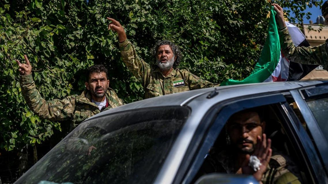 Turkey-backed Syrian opposition fighters going to Tal Abyad from Turkish gate towards Syria in Akcakale in Sanliurfa province. (AFP)