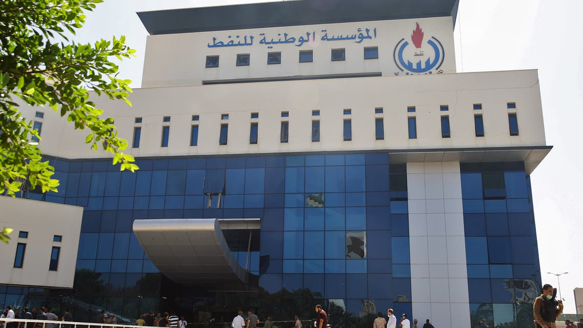 A picture taken on July 16, 2018, shows workers gathered at the building of the National Oil Corporation (NOC) of Libya, in the capital Tripoli on July 16, 2018. Four workers were kidnapped on July 14 from an oil field in southern Libya, with two of them later released, Libya's National Oil Corporation said.