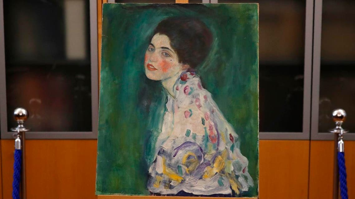 The painting which was found last December near an art gallery and believed to be the missing Gustav Klimt's painting 'Portrait of a Lady' is displayed during a press conference in Piacenza, Italy, Friday, Jan. 17, 2020. (AP)