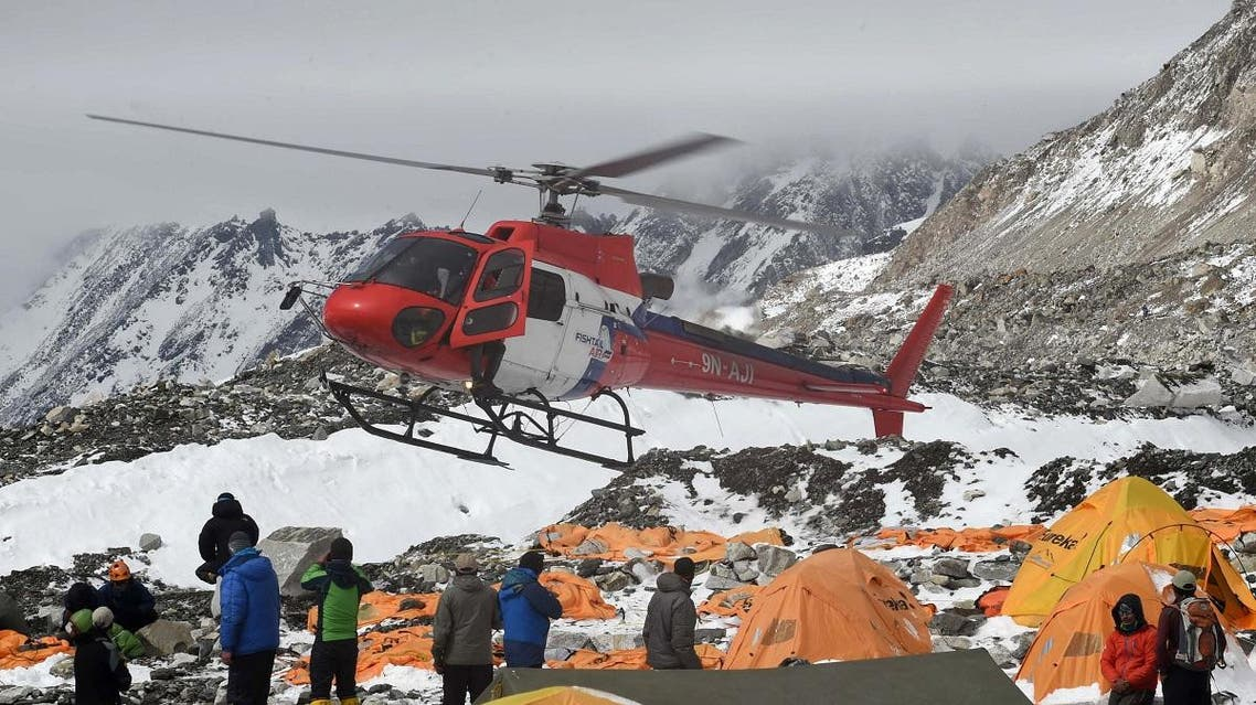 A rescue helicopter prepares to land and airlift the injured from Everest Base Camp on April 26, 2015. (File photo: AFP)