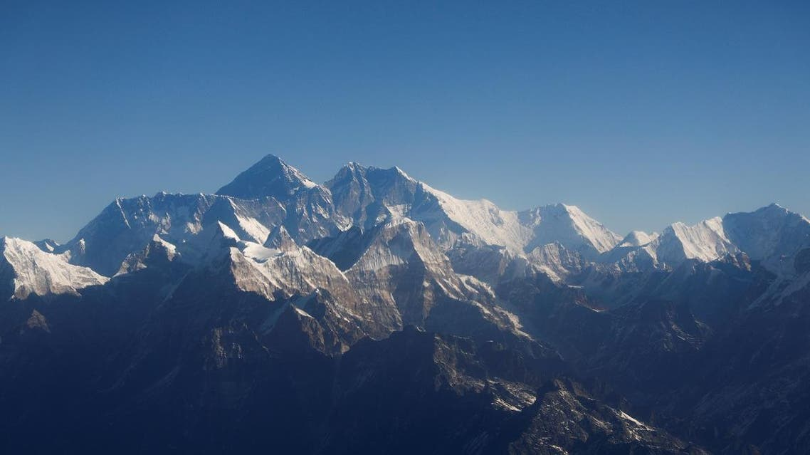 Mount Everest, the world highest peak, and other peaks of the Himalayan range are seen through an aircraft window during a mountain flight from Kathmandu, Nepal January 15, 2020. (Reuters)