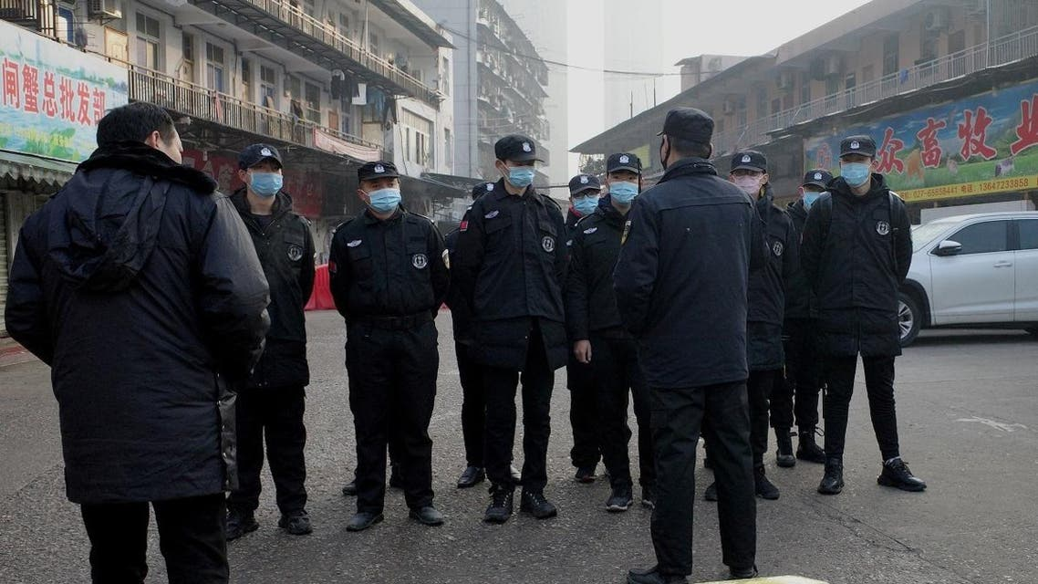 Security guards stand in front of the closed Huanan wholesale seafood market, where health authorities say a man who died from a respiratory illness had purchased goods from, in the city of Wuhan, Hubei province, on January 12, 2020. (AFP)