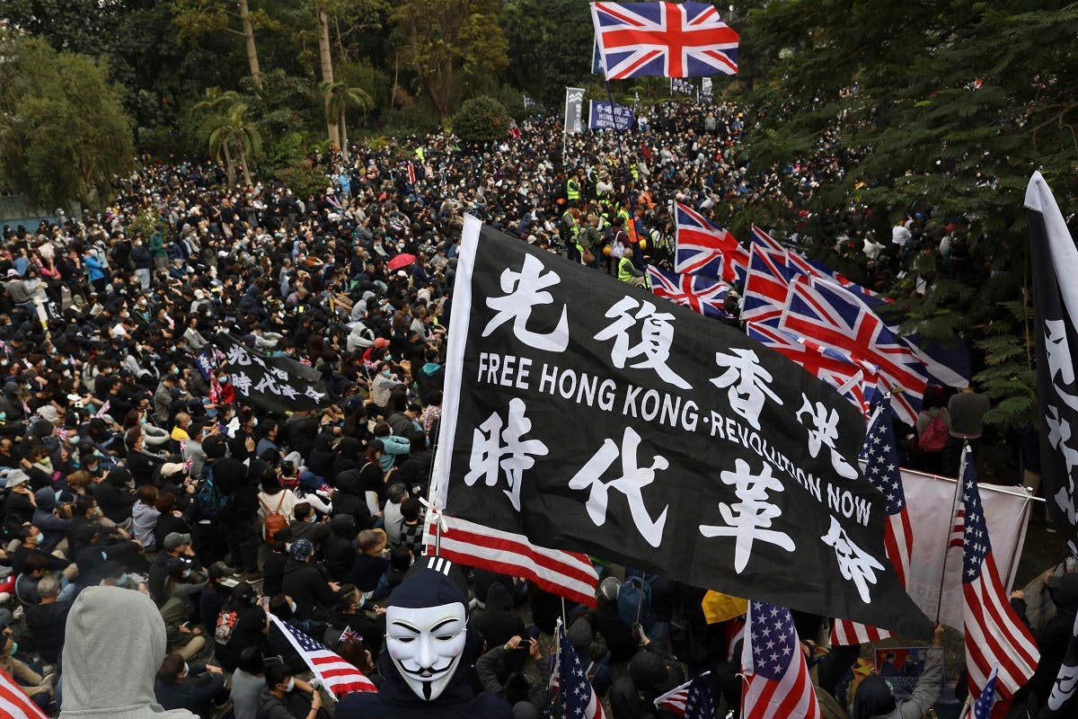 Participants wave British and US flags during a rally demanding electoral democracy in Hong Kong, on January 19, 2020. (AP)