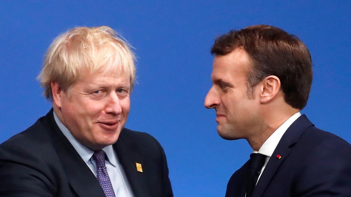A file photo of Britain's Prime Minister Boris Johnson (L) and France's President Emmanuel Macron (R). (AFP)