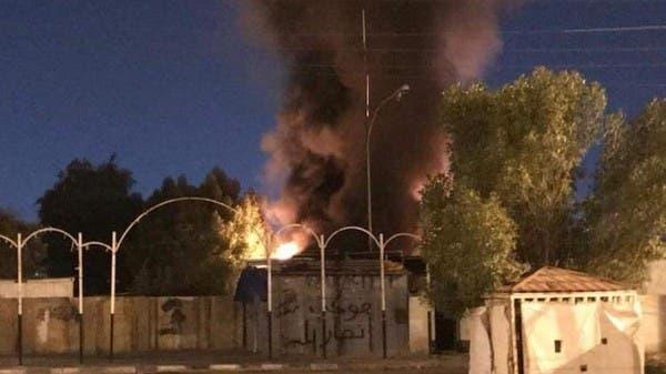 متظاهرون يحرقون مقراً لميليشيا حزب الله العراقي بالنجف