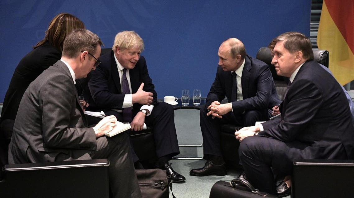 Russia's President Vladimir Putin and Britain's Prime Minister Boris Johnson meet on sideline of the Libya summit in Berlin. (Reuters)