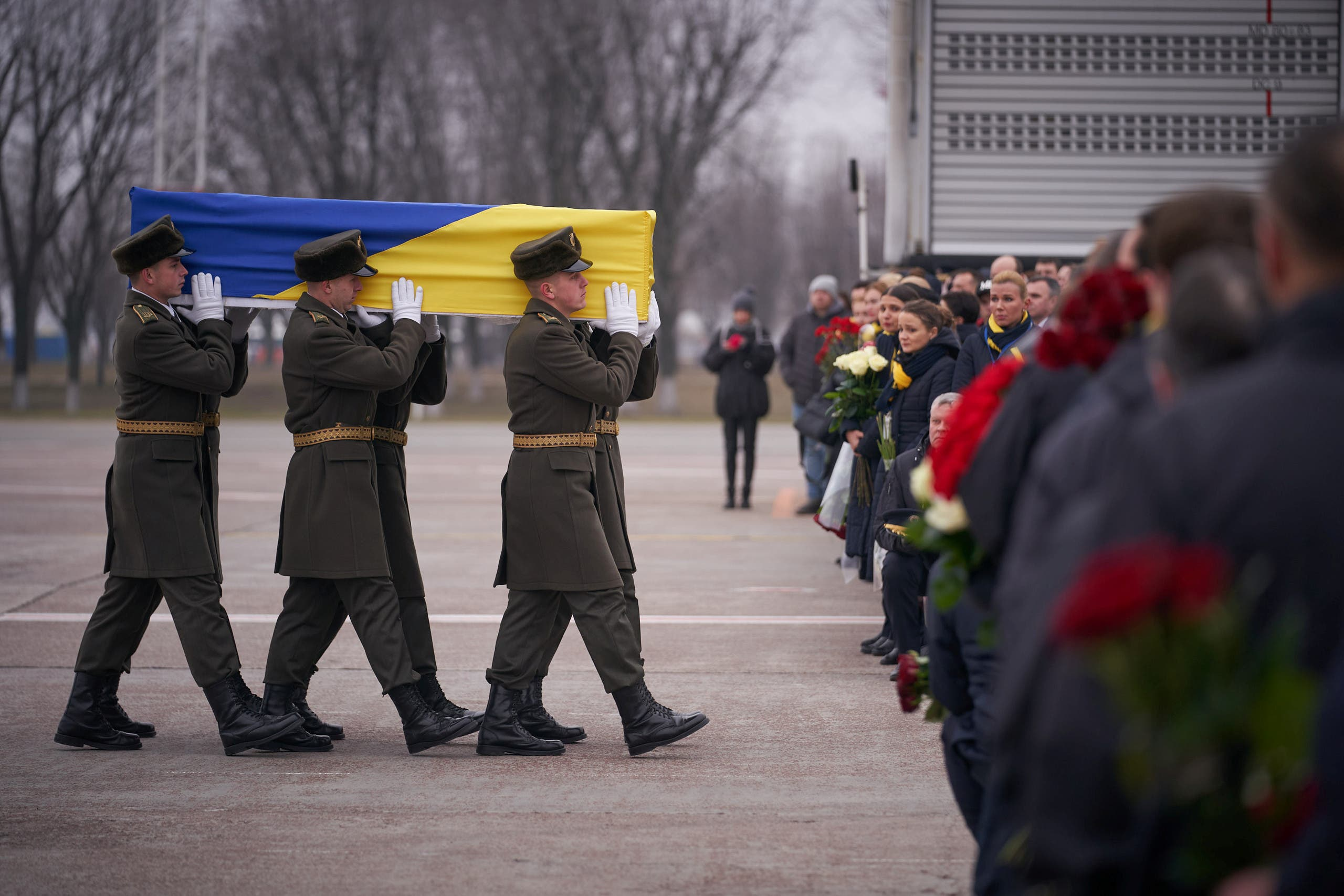 Soldiers carry a coffin of one of the eleven Ukrainian victims of the Ukraine International Airlines flight 752 plane disaster during a memorial ceremony outside Kiev. January 19, 2020. (File photo: Reuters)