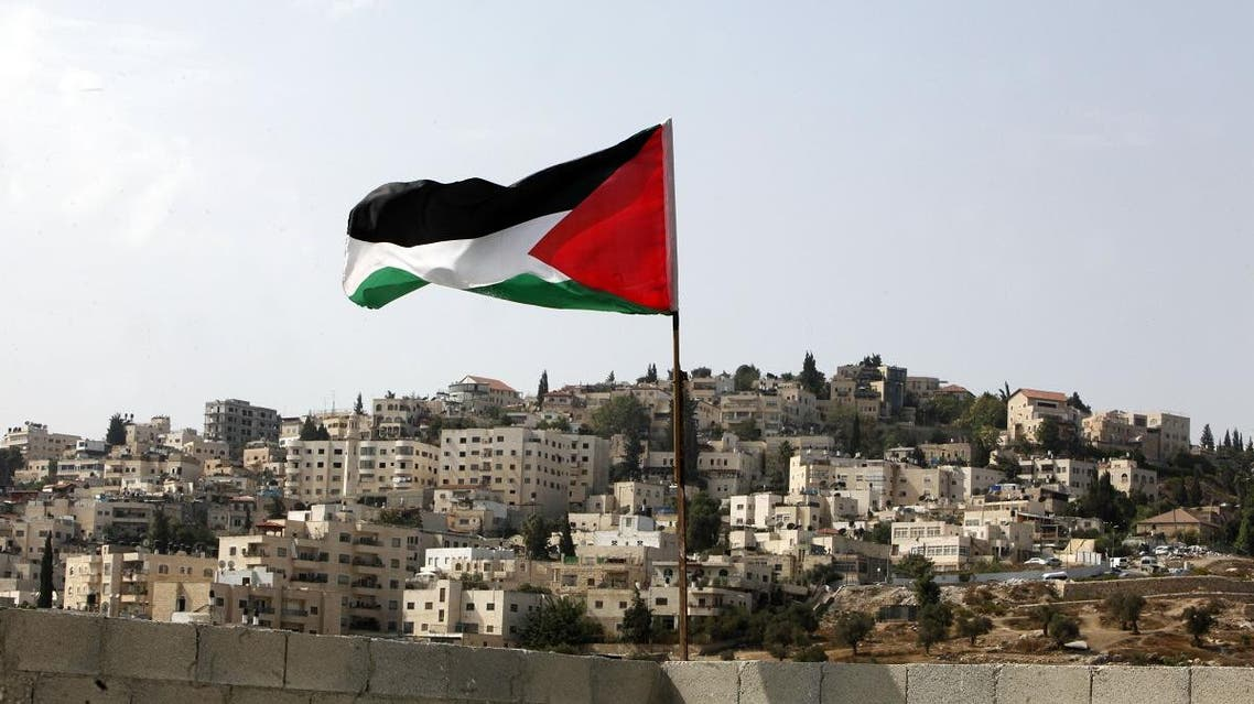 A Palestinian flag flies on the roof of an apartment in the Silwan neighborhood of east Jerusalem. (File photo: AP)