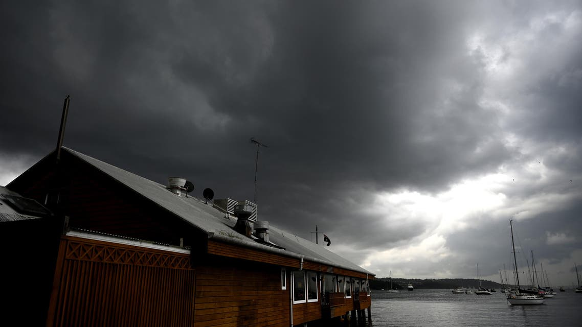 Storm clouds gather over Double Bay in Sydney on January 20, 2020. (AFP)