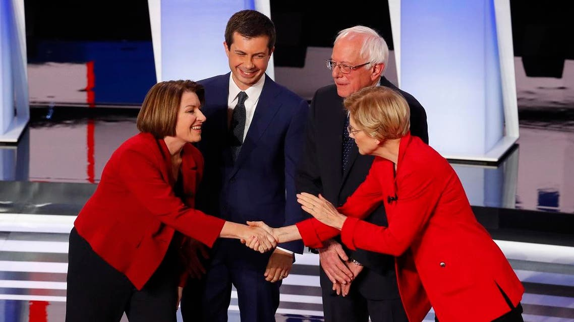 Sen. Amy Klobuchar, D-Minn., left, and Sen. Elizabeth Warren, D-Mass., right, greet each other before the first of two Democratic presidential primary debates Tuesday, July 30, 2019. (Photo: AP)