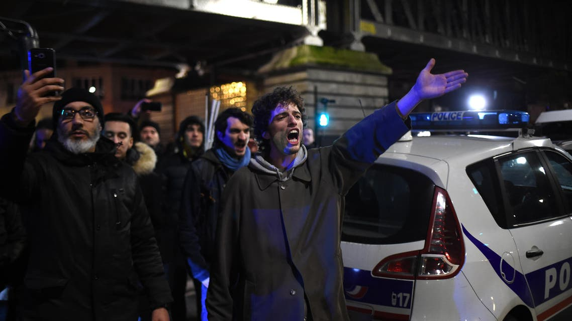 Protestors gesture next to a police car in front of the Bouffes du Nord theatre in Paris on January 17, 2020 against a pension reform. (File photo: AFP)