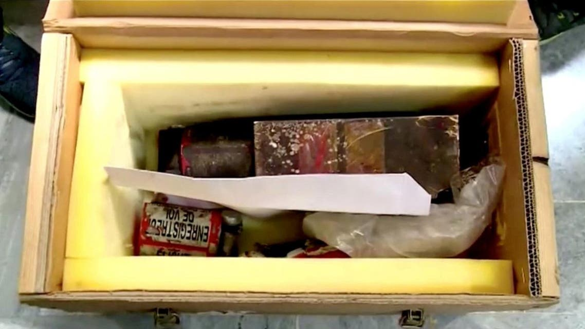 The crate containing purportedly the two black boxes recovered from the crashed Ukrainian airliner, Boeing 737-800, is seen in this still image taken from a video. (Reuters)