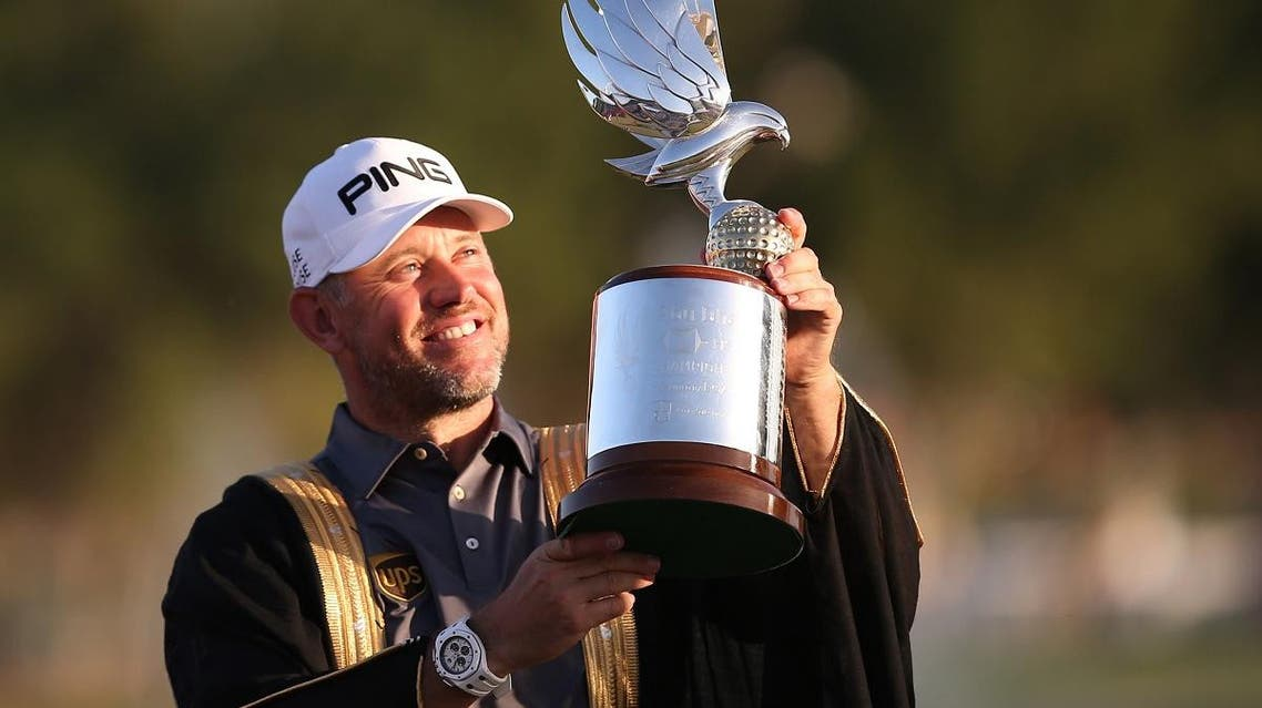 Lee Westwood of England poses with the trophy after winning the Abu Dhabi HSBC Golf Championship in the United Arab Emirates' capital. (AFP)