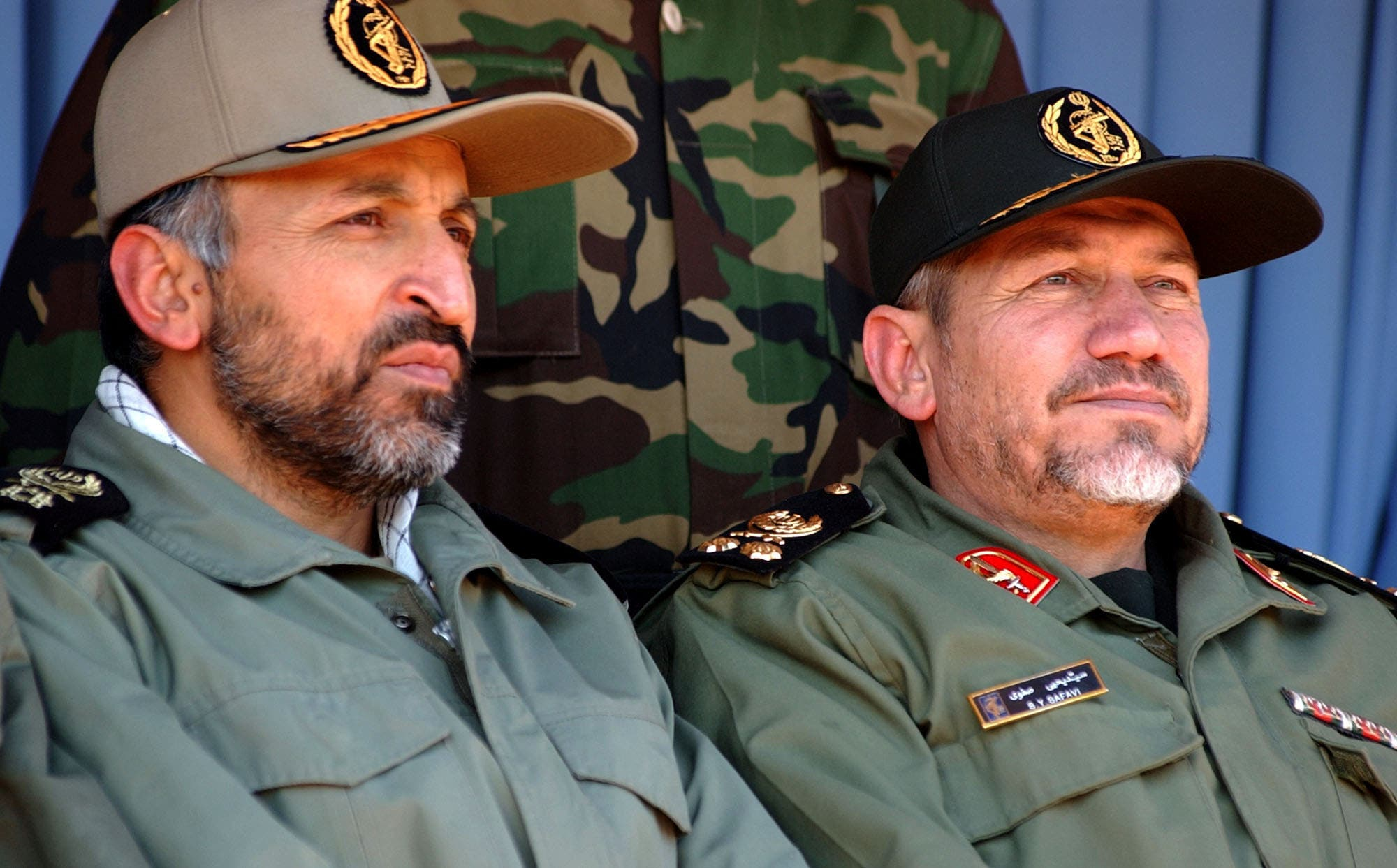 Gen. Rahim Safavi, right, and Gen. Mohammad Hejazi, attend a rally by 100,000 paramilitary forces in the southern suburbs of Tehran on Wednesday Nov. 24, 2004. (AP)
