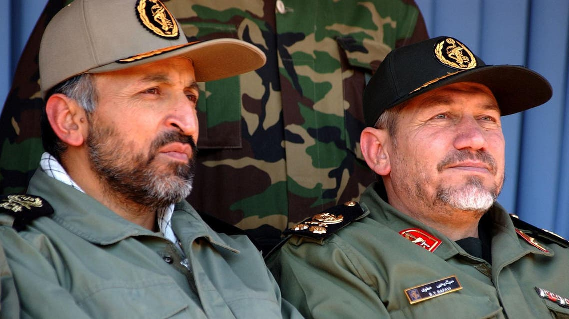 Head of the Islamic Revolutionary Guards, Gen. Rahim Safavi, right, and head of paramilitary Basiji forces Gen. Mohammad Hejazi, attend in a rally by 100,000 paramilitary forces in the southern suburbs of Tehran on Wednesday Nov. 24, 2004. Gen. Rahim Safavi, warned the U.S. of any possible attack against Iran saying America's interests and security will be endangered if Washington takes any military action against Iran. (AP Photo/Hasan Sarbakhshian)