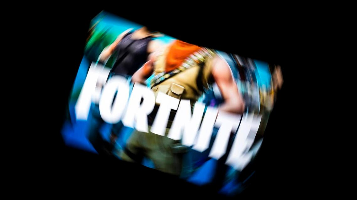 This illustration picture shows the video game Fortnite logo displayed on a tablet in Paris, on February 18, 2019. (AFP)