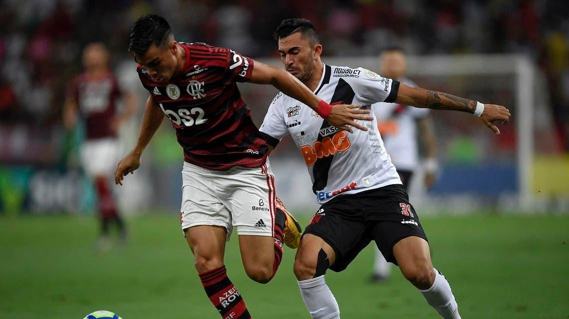 Flamengo player Reinier (L) vies for the ball with Vasco da Gama's Raul during a 2019 Brazilian Championship football match at the Maracana stadium in Rio de Janeiro, Brazil, on November 13, 2019. (AFP)