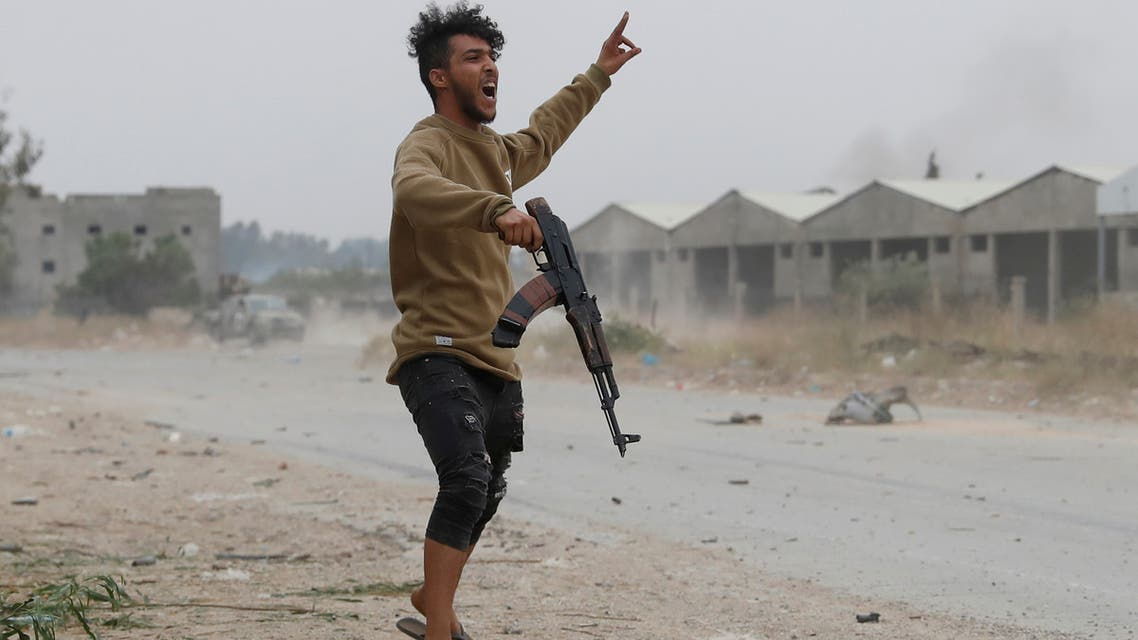 FILE PHOTO: A fighter loyal to Libya's U.N.-backed government (GNA) gestures during a clash with forces loyal to Khalifa Haftar at the outskirts of Tripoli, Libya May 21, 2019. REUTERS/Goran Tomasevic - RC11064E61F0/File Photo