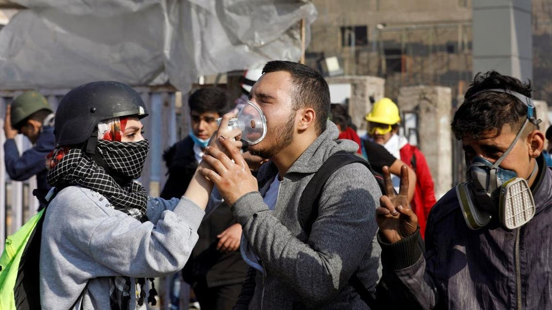 An Iraqi demonstrator receives medical help after being affected by tear gas during ongoing anti-government protests, in Baghdad, Iraq January 20, 2020. (Photo: Reuters)
