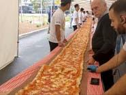 شاهد.. بيتزا بطول 103 أمتار لجمع المال للإطفاء الأسترالي