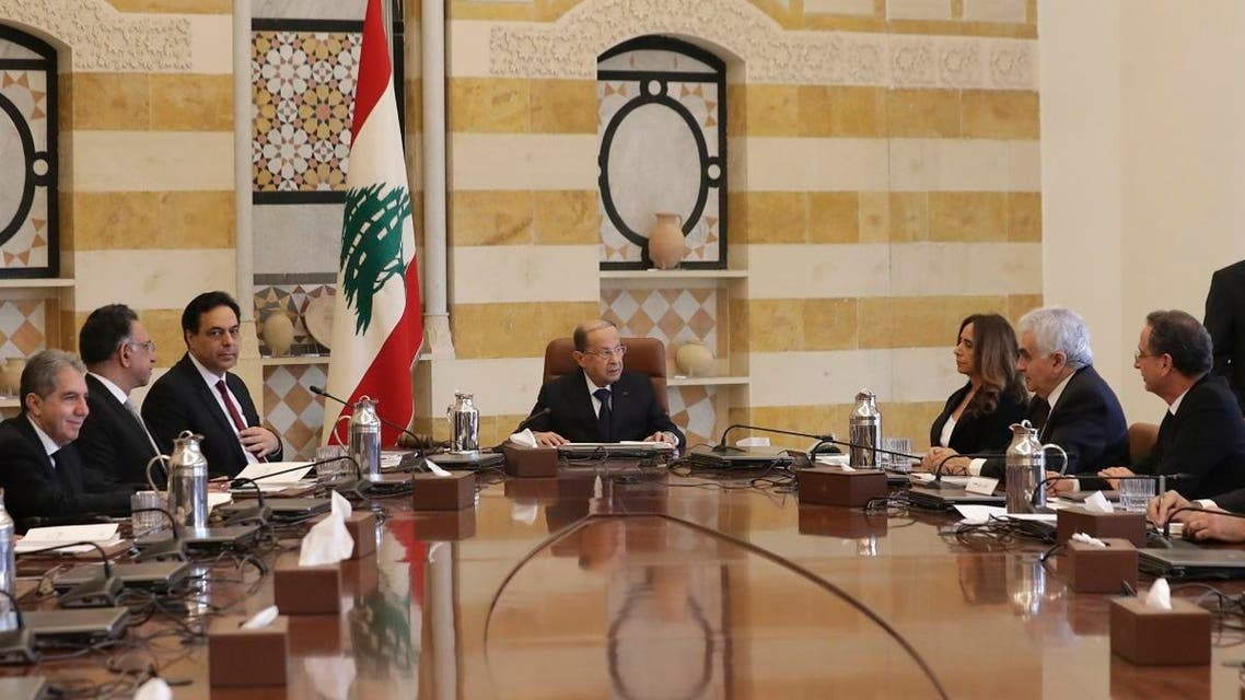 President Michel Aoun, center, speaks with Deputy Prime Minister and Minister of Defense Zeina Akr, center, right as Prime Minister Hassan Diab, center left, looks on during the cabinet meeting at the presidential palace in Baabda, east of Beirut, Lebanon Wednesday, Jan. 22, 2020. (Photo: AP)