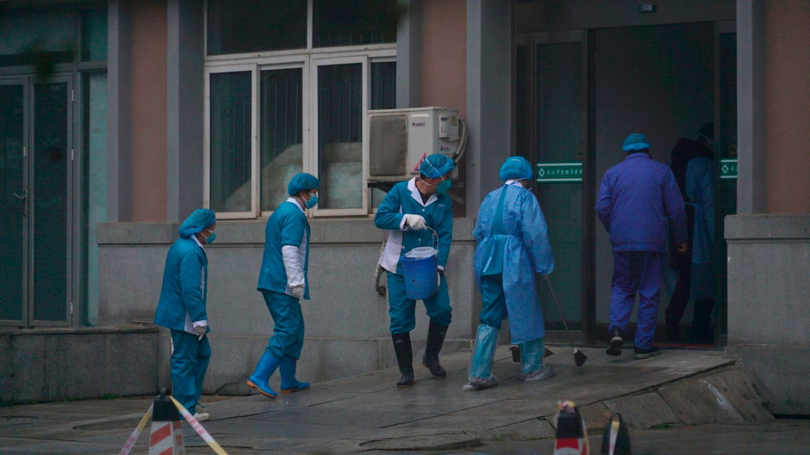 Hospital staff wash the emergency entrance of Wuhan Medical Treatment Center, where some infected with a new virus are being treated, in Wuhan, China, Wednesday, Jan. 22, 2020. (AP)