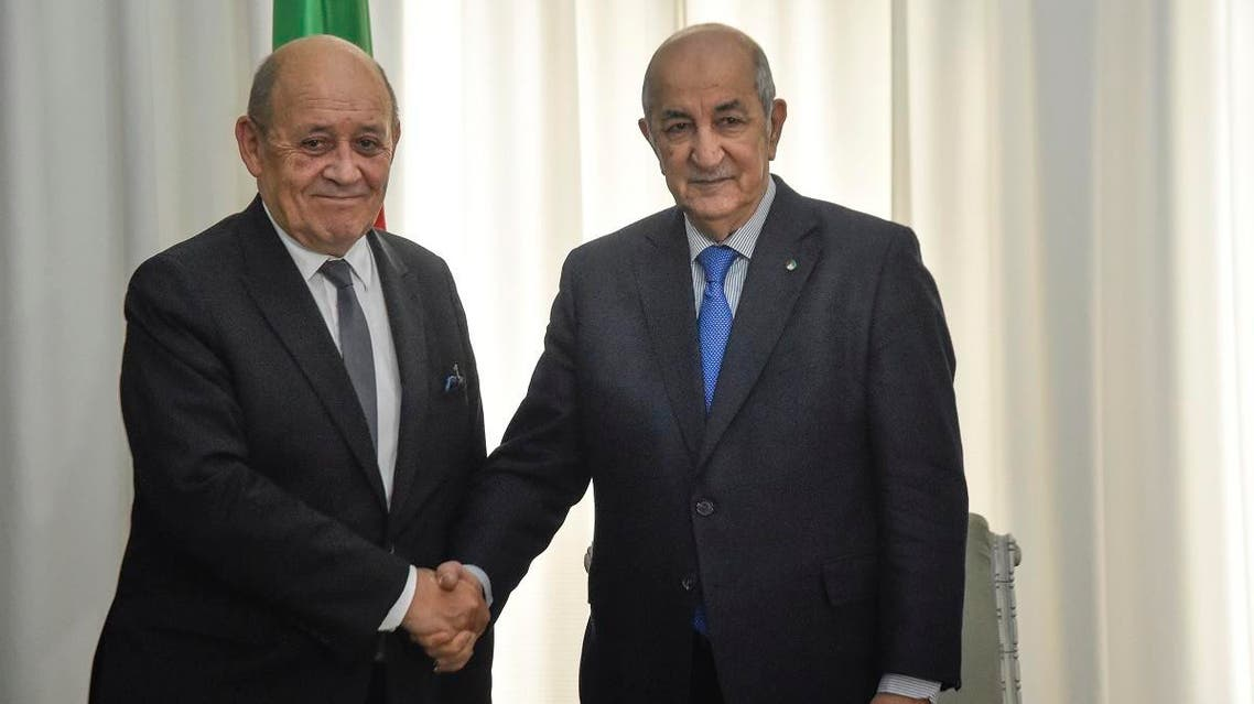 Algerian President Abdelmadjid Tebboune (R) meets with the visiting French Foreign Minister Jean-Yves Le Drian in the capital Algiers on January 21, 2020. (AFP)