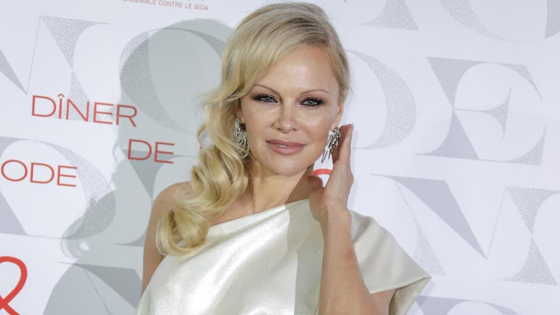 "US actress Pamela Anderson poses during a photocall upon arriving to attend the ""Diner de la Mode"" (Fashion Dinner) fundraiser dinner to benefit French anti-AIDS association Sidaction, at the Pavillon d'Armenonville in Paris. (File photo: AFP)"