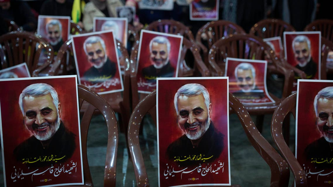 """Posters of slain Iranian Revolutionary Guard Gen. Qassem Soleimani are placed on chairs as supporters of Hezbollah leader Sayyed Hassan Nasrallah gather for his televised speech in a southern suburb of Beirut, Lebanon, Sunday, Jan. 5, 2020 following the U.S. airstrike in Iraq that killed Soleimani. The posters read: """"Sayyad of martyrs in the axis of resistance. The martyr Hajj Qassem Soleimani."""" (AP Photo/Maya Alleruzzo)"""