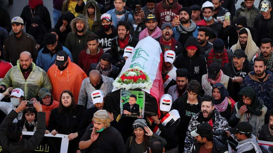 Mourners carry a mock coffin for an Iraqi demonstrator, who was killed during ongoing anti-government protests, at a symbolic funeral in Baghdad, Iraq January 21, 2020. (Photo: Reuters)