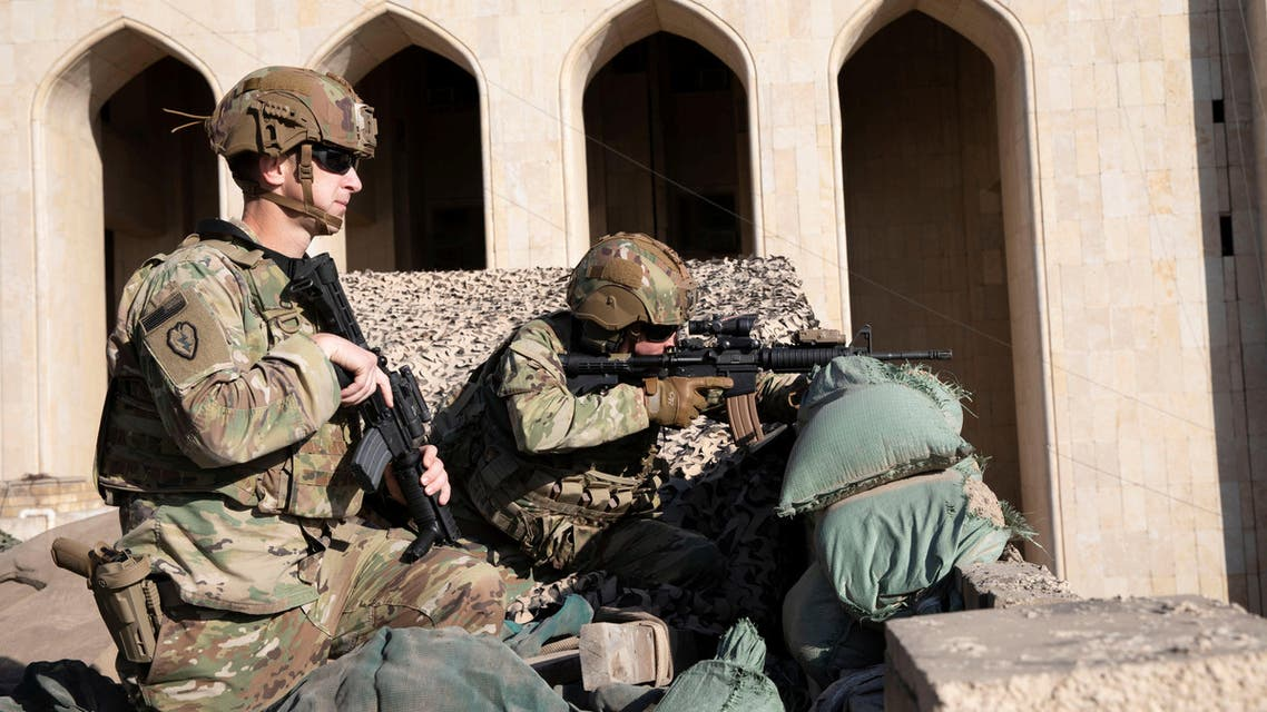 U.S. Army soldiers man a defensive position at Forward Operating Base Union III in Baghdad. (Reuters)