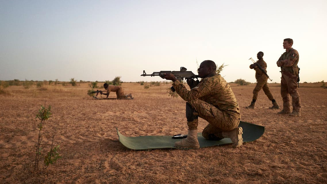 Soldiers of the Burkina Faso Army take part in shooting exercises during a joint operation with the French Army in the Soum region in northern Burkina Faso on November 12, 2019.